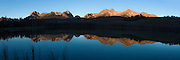 Dawn reveals the the Sawtooth mountain range reflecting in Little Redfish Lake in Idaho's Stanley Basin