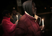 Clinton and others gather for a vigil at 2200 Massachusetts St. in Gary where an unidentified female victim was found. The body of Clinton's girlfriend was found in another abandoned building in Gary.
