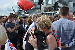 Petty Officer Carl Girt, 33, from Gosport, is welcomed home by girlfirend Sophie Haynes, 33 as he arrives on board HMS St Albans to Portsmouth Naval Base following a nine-month deployment to the Middle East.