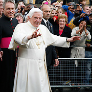 Pope Benedict XVI greets his followers as he departs St.Peter's residence in Vauxhall, London. September 2010