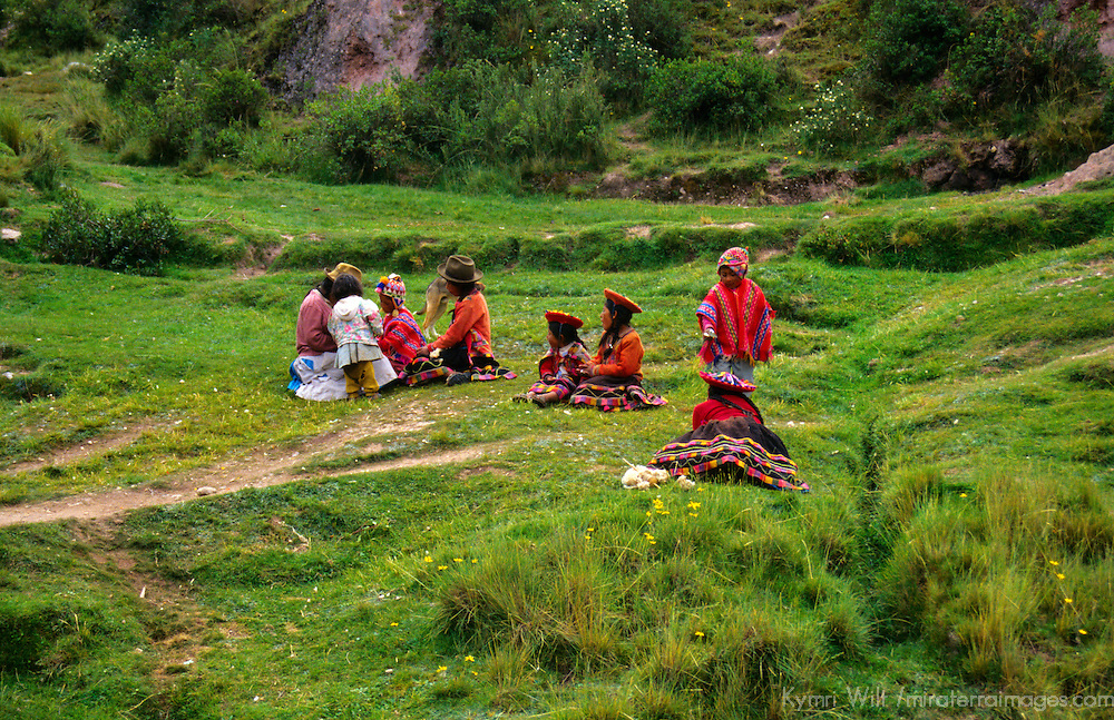 South America; Peru; Family on grass in Urubamba Valley.