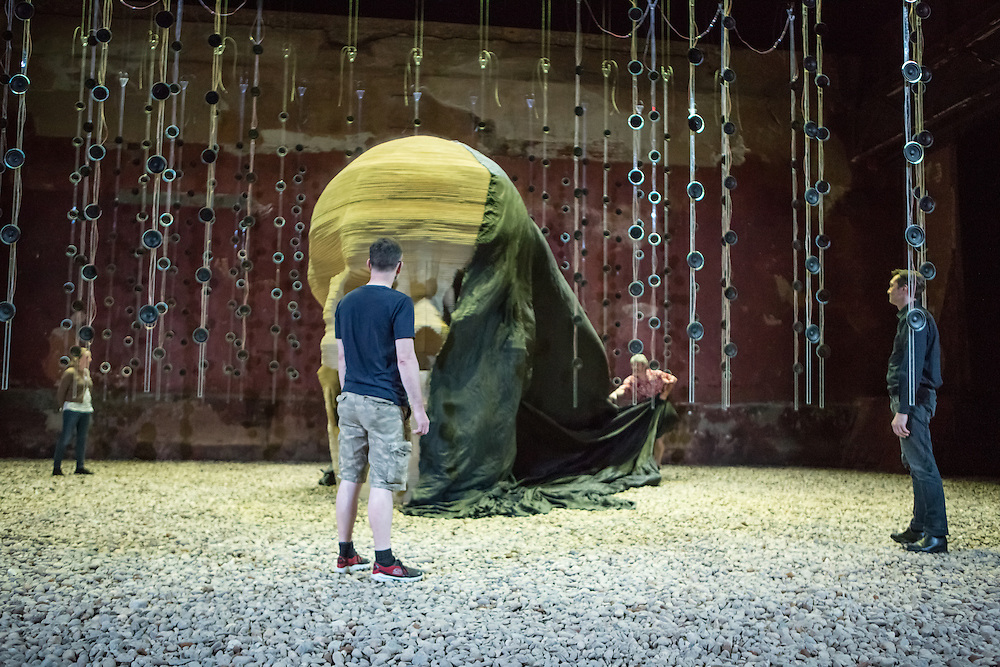 Brooklyn, NY - 17 September 2014. Andrew Bennet as Harvey, seenpulling the shroud from the giant skull, in the Pan Pan Theatre production of Samuel Becket's Embers.