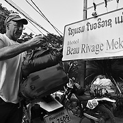 Billy Fritz, of Franklin, Pennsylvania, prepares to hit the road from Vientiane, at the start of his motorbike tour of the Ho Chi Minh Trail in Laos. Fritz, a 60-year old orthopedic surgeon and commercial helicopter pilot, was a 1st lieutenant combat engineer company commander during the Vietnam War, serving in 1967-68.