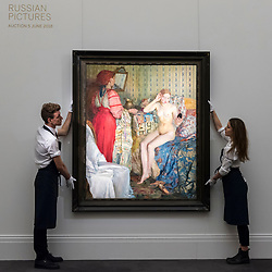 "© Licensed to London News Pictures. 01/06/2018. LONDON, UK. Sotheby's technicians present ""Toilette"", 1913, by Petr Iosifovich Smukrovich (Est. GBP200-300k) at a preview of the Russian Pictures and Russian Works of Art, Fabergé & Icons sale which will take place at Sotheby's, New Bond Street on 5 June.  Photo credit: Stephen Chung/LNP"