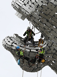 Embargoed to 0001 Monday May 29 Rope Access Technicians Andrew Pennycuick (left), Paul Smith (right) and John Benson (top) carry out the first health check on the Kelpies in Falkirk as they approach their third birthday.