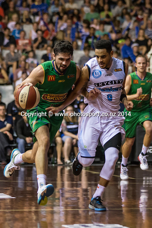 Crocodiles' Todd Blanchfield is challenged by Breakers` Corey Webster in the game between SkyCity Breakers v Townsville Crocodiles. 2014/15 ANBL Basketball Season. North Shore Events Centre, Auckland, New Zealand, Friday, December 19, 2014. Photo: David Rowland/Photosport