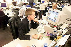 People using the internet for banking/house hunting. David Gunn from Citigate, August 10, 2000..Photo by Andrew Parsons/i-Images..