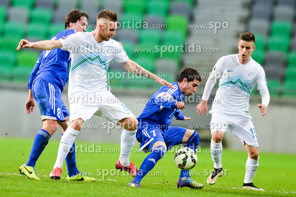 Kurtic Jasmin of Slovenia vs Hirsch Jose of San Marino during football match between NationalTeams of Slovenia and San Marino in Round 5 of EURO 2016 Qualifications, on March 27, 2015 in SRC Stozice, Ljubljana, Slovenia. Photo by Mario Horvat / Sportida