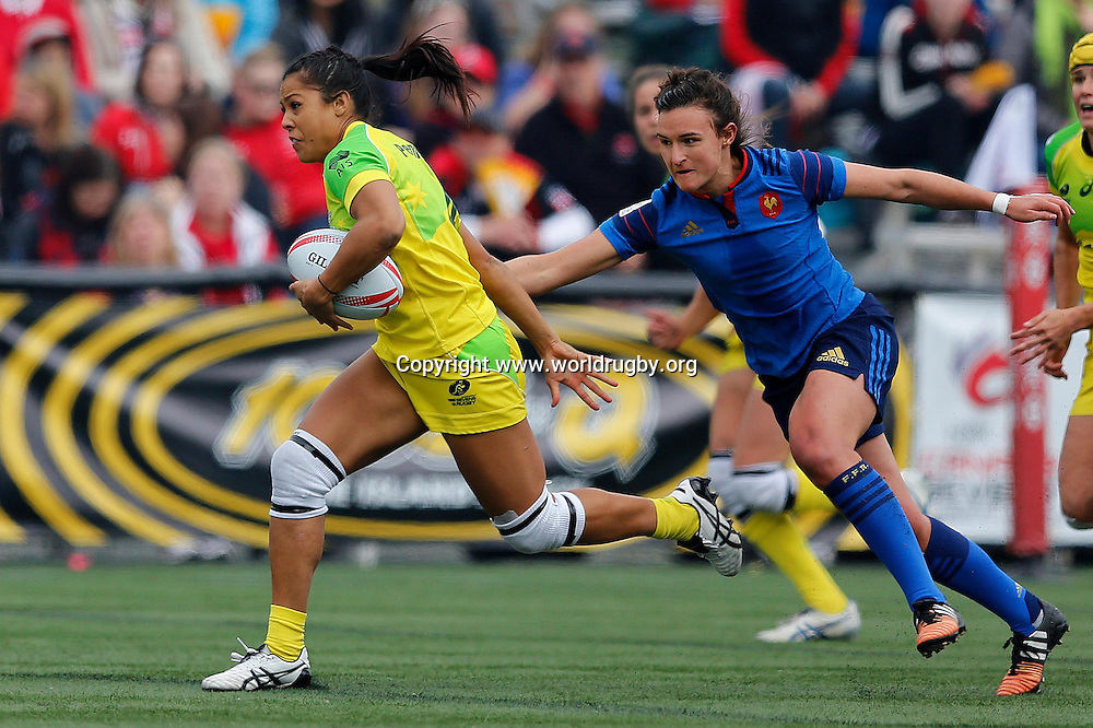 Tiana Penitani of Australia breaks through the French defence as Australia defeat France 12-7. Round 4 of the HSBC Womens Rugby Sevens World Series in Langford, Canada. 16-17 April 2016.<br /> Photo credit: www.worldrugby.org
