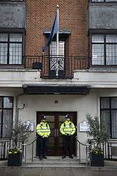 © Licensed to London News Pictures. 08/04/2018. London, UK. Police officers guard the front door as The Duke of Edinburgh spends a 5th day in the King Edward VII Hospital as he recovers from a hip operation. Photo credit: Peter Macdiarmid/LNP