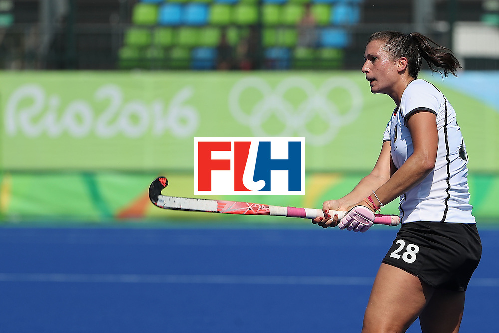 RIO DE JANEIRO, BRAZIL - AUGUST 15:  Julia Muller #28 of Germany passes the ball during the quarter final hockey game against United States on Day 10 of the Rio 2016 Olympic Games at the Olympic Hockey Centre on August 15, 2016 in Rio de Janeiro, Brazil.  (Photo by Christian Petersen/Getty Images)