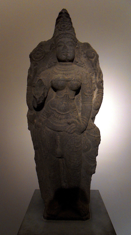 Durga  Chola dynasty (850-1100 AD) granite sculpture from Tamil Nadu, India. In Hinduism, Durga 'the inaccessible' or 'the invincible' is a form of Devi, the supremely radiant goddess, depicted as having ten arms, riding a lion or a tiger, carrying weapons and a lotus flower, maintaining a meditative smile, and practicing mudras, or symbolic hand gestures.