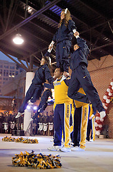 West Virginia cheerleaders perform on stage during a pep rally in downtown Memphis.