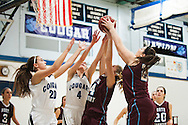 North Country's Hailey Morse (14) and Kylie Wright (24) battle for the rebound with MMU's Breanna Dooling (4) and Devyn Beliveau-Gale (20) during the girls basketball game between the North Country Falcons and the Mount Mansfield Cougars at MMU high school on Monday night February 15, 2016 in Jericho. (BRIAN JENKINS/for the FREE PRESS)