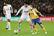 Son Heung-Min of Tottenham Hotspur (7) taking on Juventus attacker Paulo Dybala (10) during the Champions League match between Tottenham Hotspur and Juventus FC at Wembley Stadium, London, England on 7 March 2018. Picture by Matthew Redman.