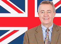 Portrait of smiling middle-aged businessman over British flag