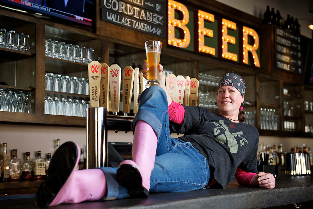 Market Garden Brewery assistant brew master Jennifer Hermann at the restaruant on Friday, May 4, 2012. Herman is one of four Ohio members of the Pink Boot Society, an international organization of women brewers.