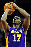 Feb. 16, 2011; Cleveland, OH, USA; Los Angeles Lakers center Andrew Bynum (17) shoots a free throw during the fourth quarter against the Cleveland Cavaliers at Quicken Loans Arena. The Cavaliers beat the Lakers 104-99. Mandatory Credit: Jason Miller-US PRESSWIRE