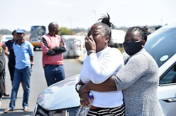 South Africa - Johannesburg - 15 September 2020 - A woman cries at the crime scene at Nancefield hostel after two men belonging to the NANDUWEtaxi association were shot dead in theirpatrol squad car. It is alleged that three gunmen opened fire killing the two occupants. Picture: Itumeleng English/African News Agency(ANA)