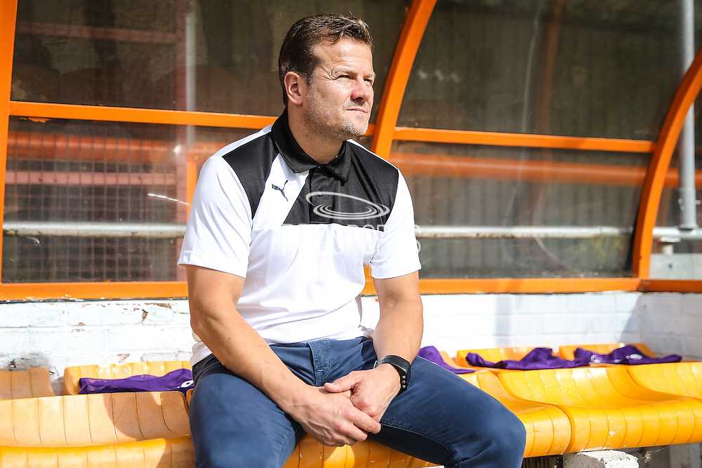 Forest Green Rovers manager, Mark Cooper sits in the dug out during the Vanarama National League match between Braintree Town and Forest Green Rovers at the Amlin Stadium, Braintree, United Kingdom on 24 September 2016. Photo by Shane Healey.