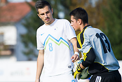 Maks Barisic of Slovenia and Victor Silverio of Andorra during football game between Slovenia and Andorra of UEFA Under19 Championship Qualifications, on October 15, 2013 in Bakovci, Slovenia. (Photo by Erik Kavas / Sportida)