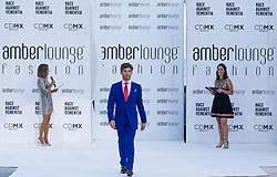 May 25, 2018 - Montecarlo, Monaco - Pierre Gasly of France and Toro Rosso Team driver presents a creation of Alessandra Vicedomini at the 15th Amber Lounge Charity Fashion Show 2018 in Monte Carlo, Monaco. (Credit Image: © Robert Szaniszlo/NurPhoto via ZUMA Press)