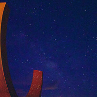 "Otto Rigan's ""Genesis"" sculpture in front of the main entrance to Spaceport America. With no light pollution in this isolated high desert location, the star viewing is amazing, and even more so set against this sculpture, which includes imbedded glass pieces that form a star map on the inside of the arch."