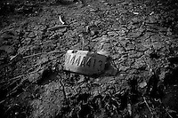 A Louisiana license plate sits in the mud of what once was a families yard in the lower ninth ward over a month after hurricane katrina made lanfall 8 October 2005 New Orleans Louisiana.  (photo by Darren Hauck).