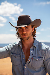 hot cowboy with long brown hair and blue eyes