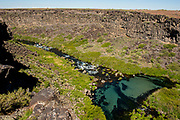 Scenic view of the blue water plunge pools at Box Canyon State Park in Wendell, Idaho.