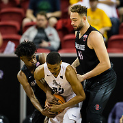 09 March 2018: San Diego State men's basketball takes on Nevada in the quarterfinal round of the Mountain West Conference Tournament. San Diego State Aztecs forward Jalen McDaniels (5) and center Kameron Rooks (45) battle Nevada Wolf Pack guard Josh Hall (33) for the ball in the first half. The Aztecs cruise past the Wolfpack 90-73 to move on to the Championship game tomorrow afternoon at 3pm.<br /> More game action at www.sdsuaztecphotos.com