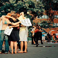 A group of young people giving free hugs, Union Square, New York City.