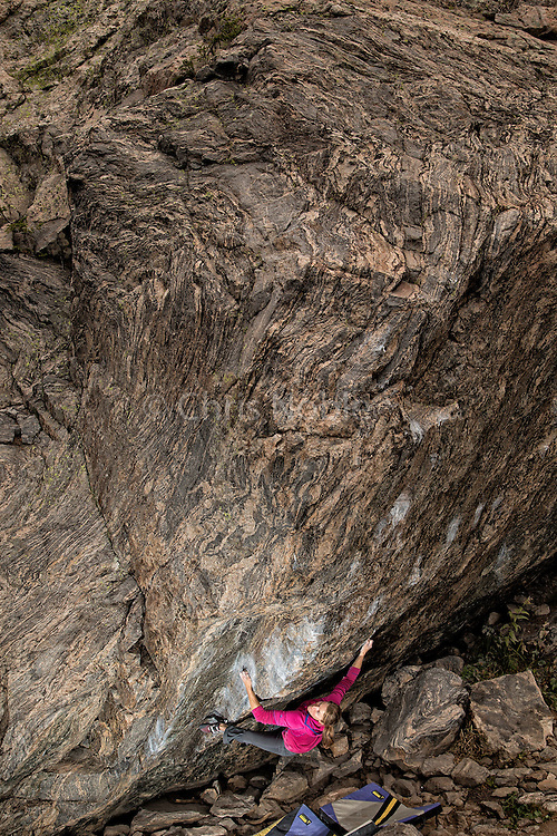 "Porfessional boulderer Angie Payne working on ""Freaks of the Industry"" V13, Chaos Canyon, Rocky Mountain National Park."