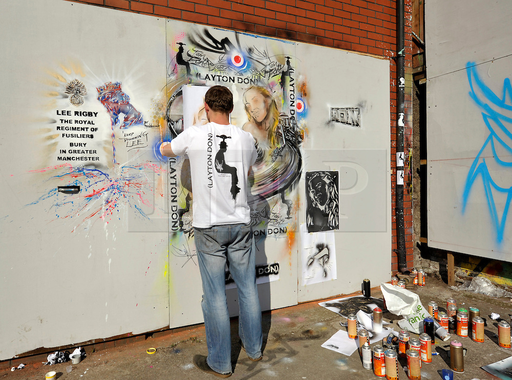 © Licensed to London News Pictures. 25/05/2013. Bristol, UK.  Artist Paul Don Smith with his piece of Graffiti art at Upfest festival of urban street art in Bristol commemorating soldier Lee Rigby who was murdered in Woolwich.  25 May 2013..Photo credit : Simon Chapman/LNP
