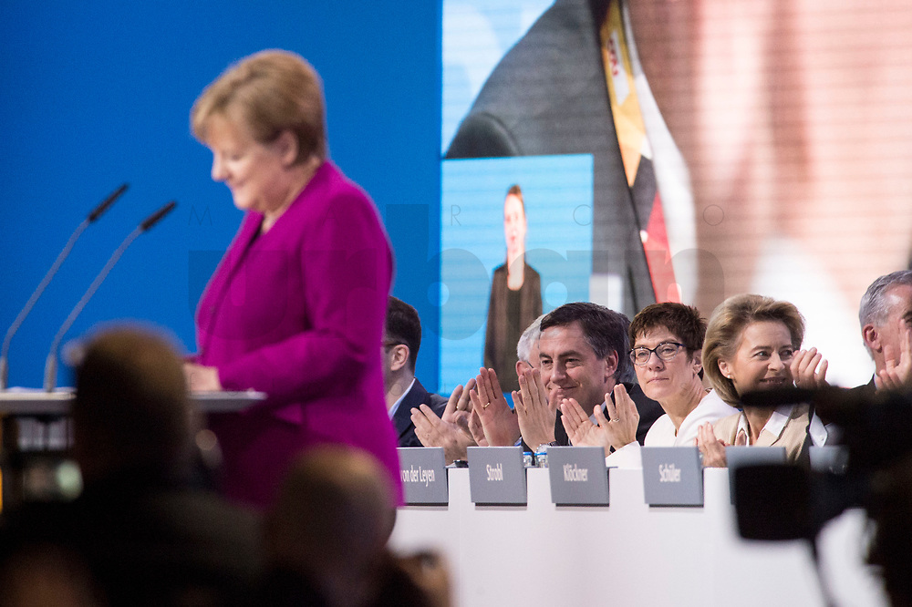 26 FEB 2018, BERLIN/GERMANY:<br /> Annegret Kramp-Karrenbauer (R), CDU, desig. Generalsekraetrin, waehrend der Rede von Angela Merkel, CDU, Bundeskanzlerin, zur Eroeffnung des Parteitages, CDU Bundesparteitag, Station Berlin<br /> IMAGE: 20180226-01-026<br /> KEYWORDS: Party Congress, Parteitag, speech