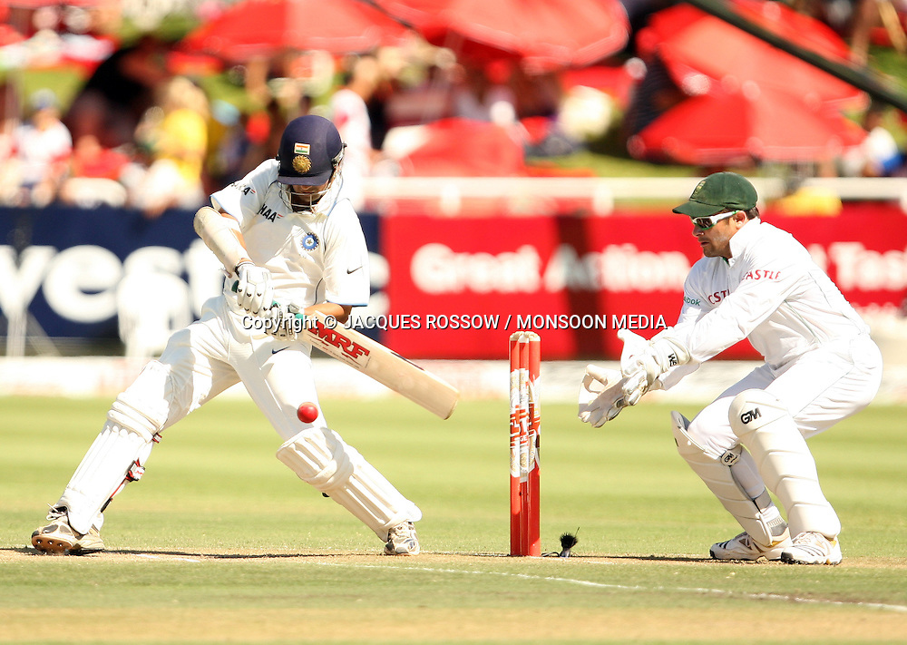 Gautam Gambir swings wildly at a delivery and misses with Mark Boucher standing up to the stumps standing  during Day 2 of the third and final Test between South Africa and India played at Sahara Park Newlands in Cape Town, South Africa, on 2 January 2011. Photo by Jacques Rossouw / MONSOON MEDIA