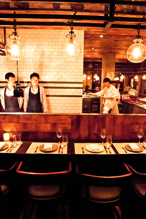 Central dining bar and wood fired oven.