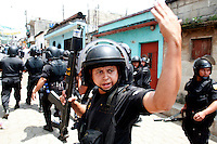 A member of the special anti riot police force calls for more officers as it takes on protestors Tuesday Sept. 11, 2007, Palin Guatemala. A angry mob took to the streets and went on to burn down the mayors office as well as his home in demonstration after and clash with local police on the previous day. Residents accuse the mayor of, among other things, of bussing voters for the elections on Sept. 9 2007.   (photo by/ Darren Hauck)..................