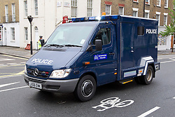 © Licensed to London News Pictures. 30/05/2013. London, UK. The police van carrying Michael Adebowale, one of two men charged with killing Drummer Lee Rigby in Woolwich last week is seen arriving at Westminster Magistrates in London today (30/05/2013). Photo credit: Matt Cetti-Roberts/LNP