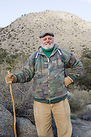 Portrait of senior male hiker holding hiking pole