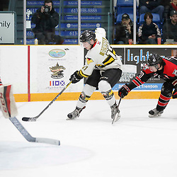 TRENTON, ON  - MAY 5,  2017: Canadian Junior Hockey League, Central Canadian Jr. &quot;A&quot; Championship. The Dudley Hewitt Cup. Game 7 between The Georgetown Raiders and The Powassan Voodoos. Austin Cho #20 of the Georgetown Raiders tries to get the puck from Parker Bowman #17 of the Powassan Voodoos <br /> (Photo by Amy Deroche / OJHL Images)