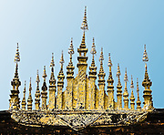 A metalic adornment called a &quot;dok so fa&quot; on the rooftop of a wat. This beautiful ornamentation with parasols pointing to the sky is said to symbolise the universe.<br /> (Photo by Matt Considine - Images of Asia Collection)