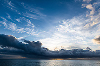 Scattered clouds at dawn over the ocean, Arniston, Western Cape, South Africa