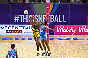 Fijian goal keeper Episode Kahatoka knocks the ball away from Jamaican goal shooter Romelda Aiken during the 2019 Netball World Cup match between Jamaica and Fiji at M & S Bank Arena, Liverpool, United Kingdom on 12 July 2019.