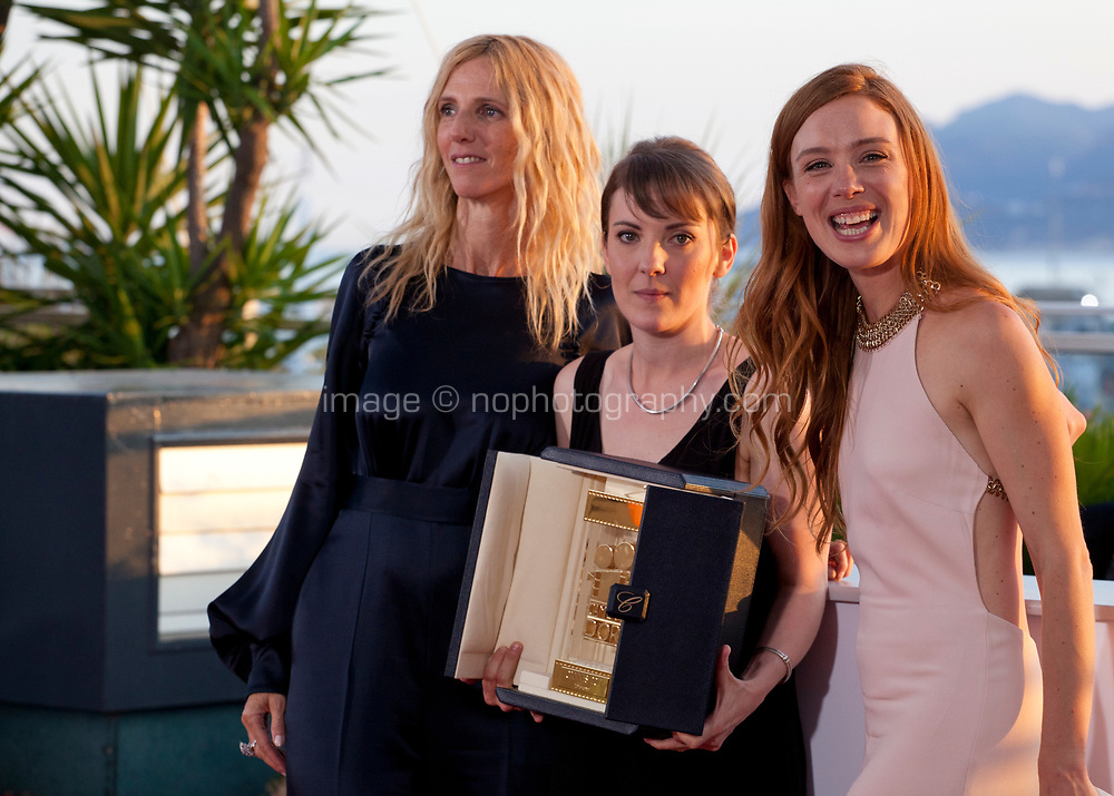 President of the Camera d'Or jury Sandrine Kiberlain, actress Laetitia Dosch and director Leonor Serraille, winner of the Camera d'Or for best first film Jeune femme (Montparnasse-Bienvenüe) at the Award Winner's Photocall at the 70th Cannes Film Festival Saturday 27th May 2017, Cannes, France. Photo credit: Doreen Kennedy