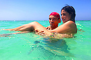 Couple swimming at Guadalavaca, Holguin, Cuba.