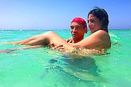 Couple swimming at Guadalavaca, Holguin, Cuba.
