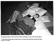 Sleeping during the Trinity Hall May Ball. Cambridge. 14 June 1983. film 83406f15<br />