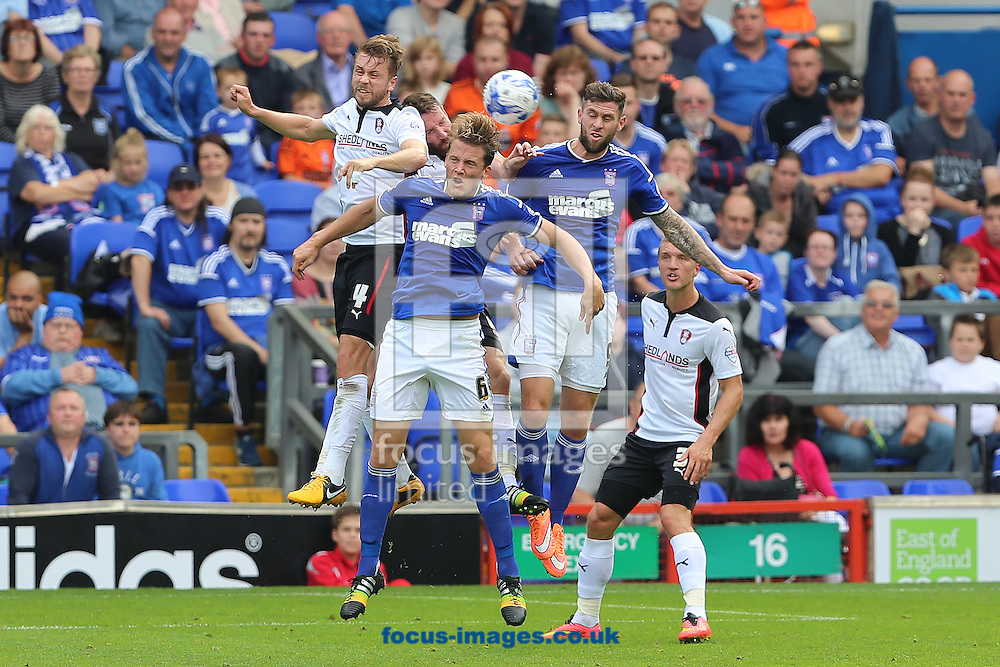 Christophe Berra and Daryl Murphy of Ipswich Town battle with Kari Arnason and Kirk Broadfoot of Rotherham United during the Sky Bet Championship match at Portman Road, Ipswich<br /> Picture by Richard Calver/Focus Images Ltd +447792 981244<br /> 27/09/2014