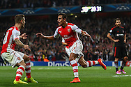 Alexis Sanchez of Arsenal (right) celebrates scoring the opening goal against Besiktas J.K. with Jack Wilshere of Arsenal (left) during the UEFA Champions League match at the Emirates Stadium, London<br /> Picture by David Horn/Focus Images Ltd +44 7545 970036<br /> 27/08/2014